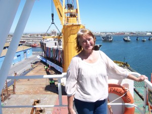 Outer Harbour, Port Adelaide. City of Adelaide being 'skidded' off MV Palanpur onto barge Bradley, her temporary home.